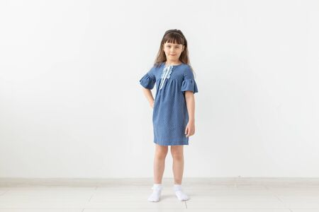 model, seamstress, designer, people concept - child girl in blue dress over the white background