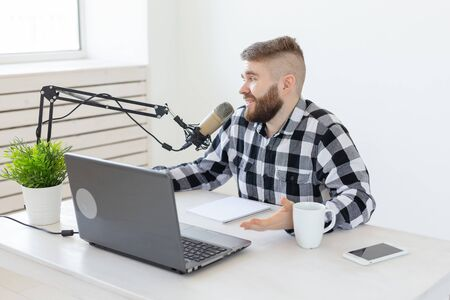 Streamer, blogger and media concept - radio dj working at studio