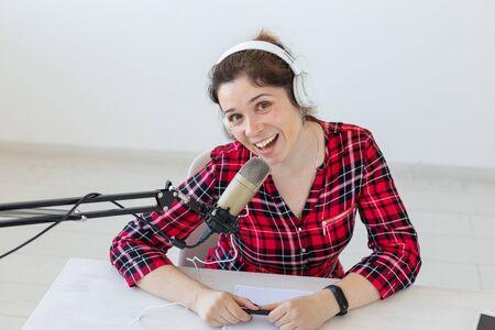 Radio host concept - Portrait of woman radio presenter with headphones