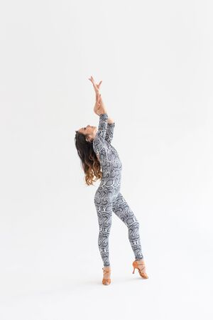 Latina dance, strip dance, contemporary and bachata lady concept - Woman dancing improvisation and moving her long hair on a white background 写真素材