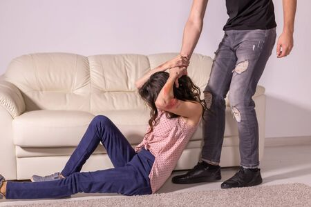 Domestic violence, abuse and victim concept - aggressive man dragging helpless woman by hair Stok Fotoğraf