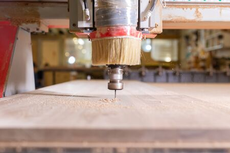 wood, metal, production concept - the cutting instrument, focus at the cutting process