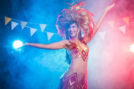 Carnival, belly dance and holiday concept - Beautiful female samba dancer wearing gold costume and smiling Standard-Bild - 133505241