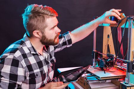 Male architect using 3D printer in office Stock fotó