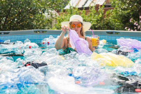 Ecology, plastic trash, environmental emergency and water pollution - Shocked woman in a dirty swimming pool