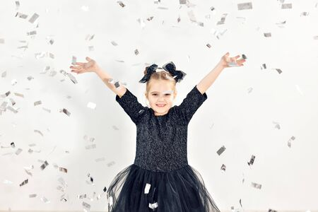 Party, holidays, new year and celebration concept - Female child throwing confetti.