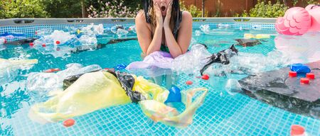 Ecology, plastic trash, environmental emergency and water pollution - Screaming woman with a plastic bag over his head in a dirty swimming pool