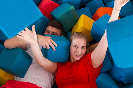 Fitness, fun, leisure and sport activity concept - Funny happy man and woman having fun on a trampoline indoors Stock fotó - 138460770