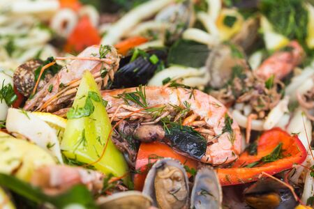 Street food and meal - Spanish paella close-up with shrimp and clams