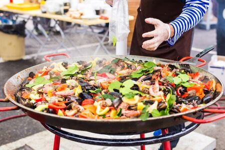 Spanish paella prepared in the street restaurant Reklamní fotografie