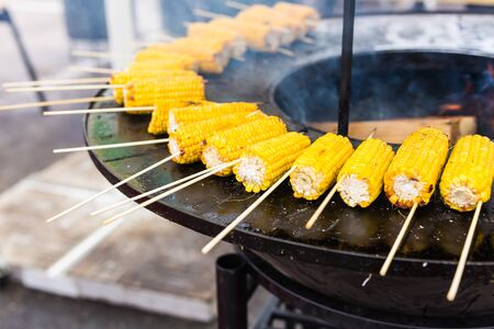 Street food concept - Close up grilled corn food on the street.