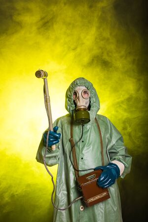Man in the gas mask and chemical suit. The worker doing measure radioactivity Reklamní fotografie
