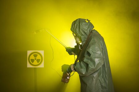 Radiation and danger concept - Man in old protective hazmat suit.