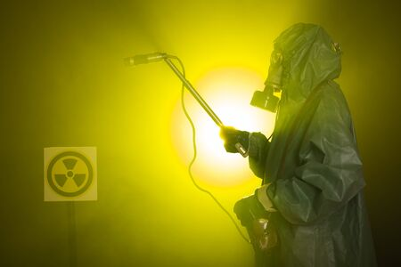 Radiation and danger concept - Man in old protective hazmat suit Stock Photo