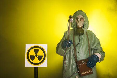 Radiation and danger concept - Man in old protective hazmat suit. Reklamní fotografie
