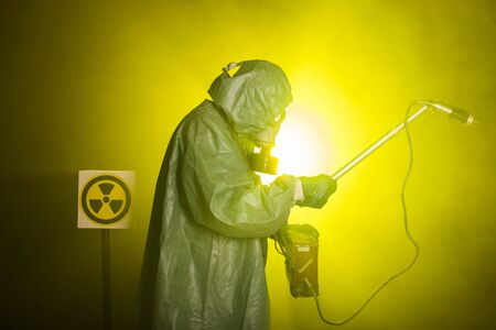 Radiation and danger concept - Man in old protective hazmat suit