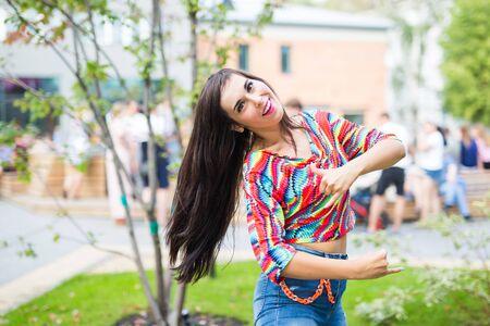 Street shaabi dance and urban dancer concept - Cheerful belly dancer dancing with arabic music on the street Standard-Bild