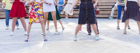 Social dance and flashmob concept - Fun and dance with in the summer on a city street. Close-up of dancers feet. Foto de archivo
