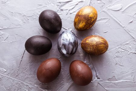 Holidays, design and modern easter concept - Black, brown, silver and gold easter eggs style minimalism.