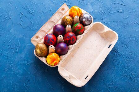 Handmade painted Easter eggs in egg box