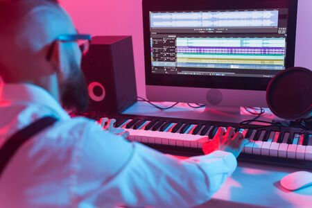 Professional musician recording synthesizer in digital studio at home, Music production technology concept. Stockfoto