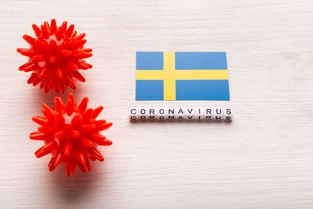Abstract virus strain model of 2019-nCoV middle East respiratory syndrome coronavirus or coronavirus COVID-19 with text and flag Sweden on white background. Virus pandemic protection concept.