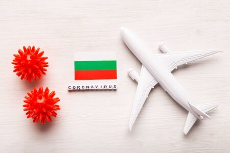 Flight ban and closed borders for tourists and travelers with coronavirus covid-19. Airplane and flag of Bulgaria on a white background. Coronavirus pandemic.