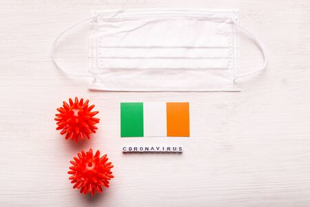 Coronavirus 2019-nCoV concept. Top view protective breathing mask and flag of Ireland. Novel Chinese Coronavirus outbreak.