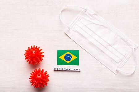 Coronavirus 2019-nCoV concept. Top view protective breathing mask and flag of Brazil. Novel Chinese Coronavirus outbreak.