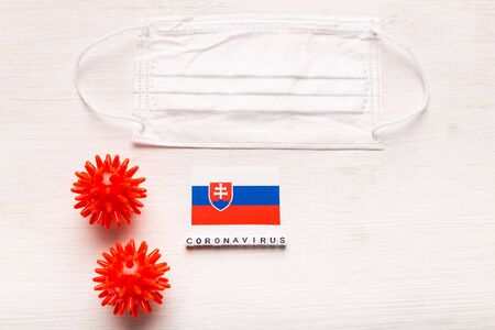 Coronavirus 2019-nCoV concept. Top view protective breathing mask and flag of Slovakia. Novel Chinese Coronavirus outbreak.