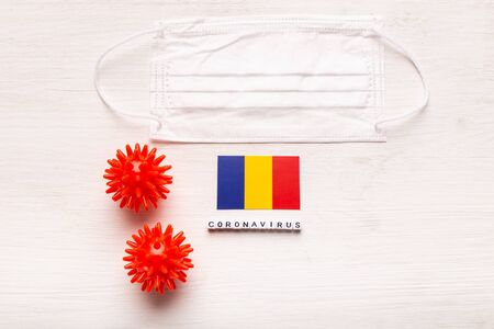 Coronavirus covid-19 concept. Top view protective breathing mask and flag of Romania. Novel Coronavirus outbreak.