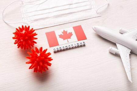 Flight ban and closed borders for tourists and travelers with coronavirus covid-19. Airplane and flag of Canada on a white background. Coronavirus pandemic.