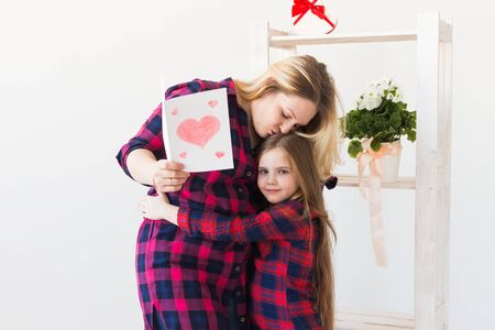 Mothers Day, holidays and family holidays - Mother holds greeting card from her lovely daughter.