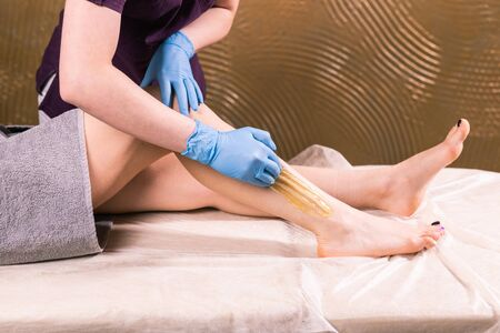 Sugaring epilation skin care with liquid sugar at legs close-up. You can see her smooth and hair free legs after hair removal. Beauty and cosmetology. Stock fotó