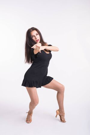 Latina dance, strip dance, contemporary and bachata lady concept - Woman dancing improvisation and moving her long hair on a white background.