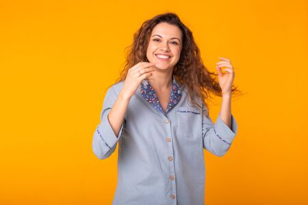 Close up portrait of lovely cute funny lady smiling and having holidays dressed in comfortable clothing isolated on yellow background. Holidays, party and summer concept.