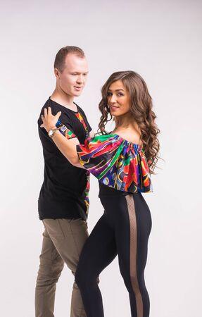 Funny couple dancing social dance. Kizomba or bachata or semba or taraxia , on white background. Social dance concept.