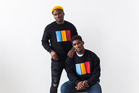 Street fashion and friendship concept - Two african american young men in black stylish sweatshirts. Foto de archivo