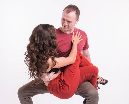 Beauty couple dancing social dance. Kizomba or bachata or semba or taraxia , on white background. Social dance concept.