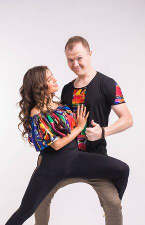 Funny couple dancing social dance. Kizomba or bachata or semba or taraxia , on white background. Social dance concept. Imagens