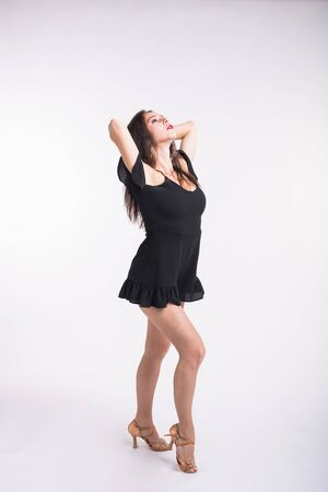 Latina dance, strip dance, contemporary and bachata lady concept - Woman dancing improvisation and moving her long hair on a white background. 写真素材