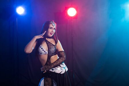 Spirituality dance. Beautiful sexy woman with luxury glossy eastern make-up dancing tribal fusion. Belly dance. 写真素材