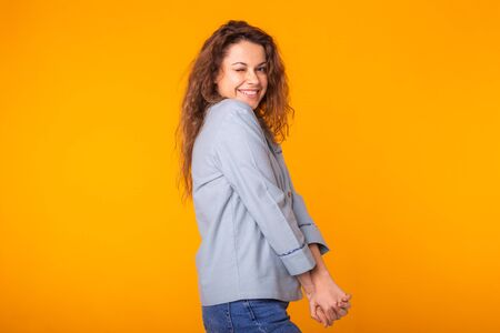 Close up portrait of lovely cute funny lady making winks having holidays dressed in comfortable clothing isolated on yellow background. Holidays, party and summer concept.