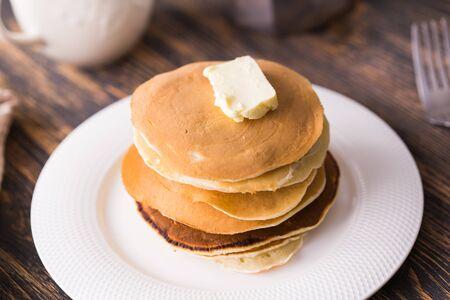 Homemade american pancakes. Healthy morning breakfast. Rustic style.