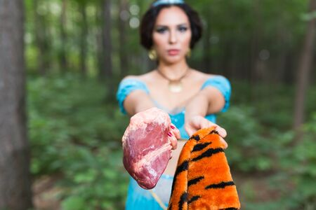 Woman calls stop eating meat. Vegetarian campaign against kills animals. Eco friendly behaviour. Protect the animals.