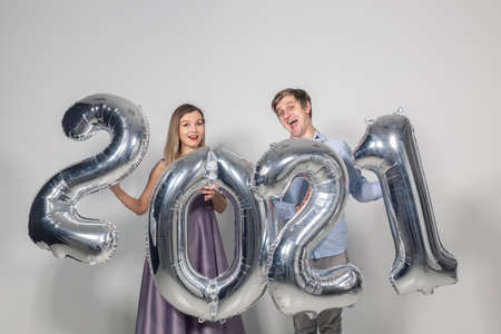 Party, people and new year holidays concept - woman and man celebrating new years eve 2021 Stock fotó