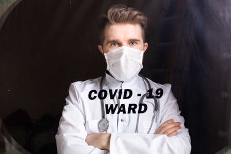 Medicine and health care concept. Man doctor in hospital. Doctor wearing protective mask checking and take care infected people from covid-19.
