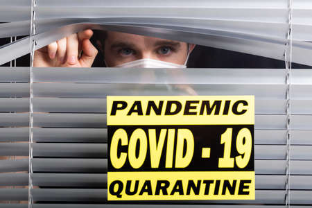 Hospital quarantine or isolation of patient standing alone in room with hopeful for treatment of Coronavirus COVID-19 Pandemic, Outbreak Efforts prevent virus spreading hazard controls concept. 版權商用圖片