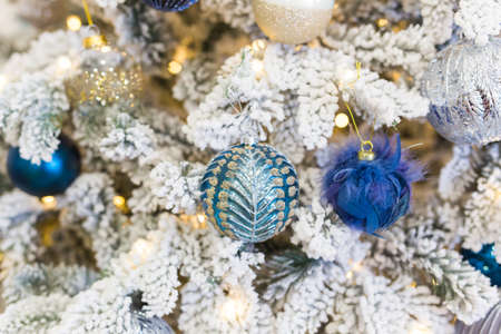Christmas-tree decorations on a christmas fir-tree. Holidays and decor concept. 版權商用圖片 - 155318981