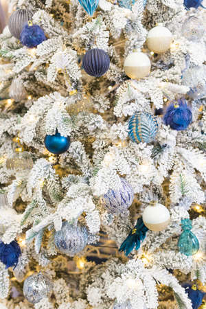 Christmas tree with colorful baubles. Holidays and decor concept.